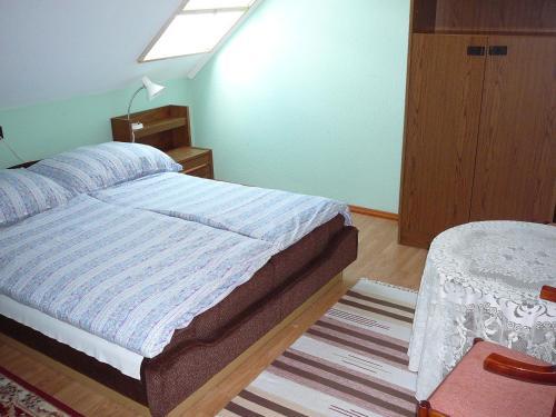 Cama o camas de una habitación en Tilesch Apartment