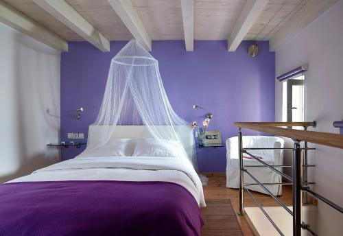 A bed or beds in a room at Boutique Hotel Fortino