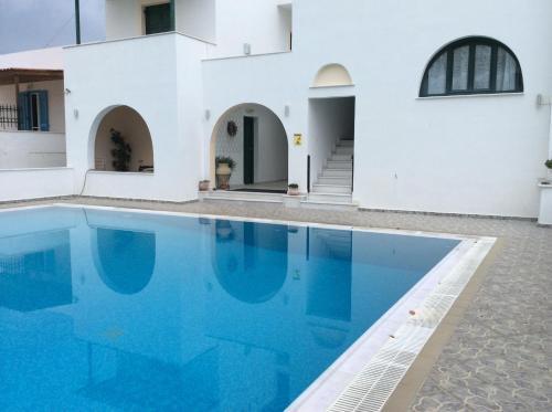 The swimming pool at or near Iliovasilema