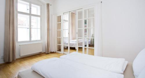 A bed or beds in a room at Apartment U hroznu