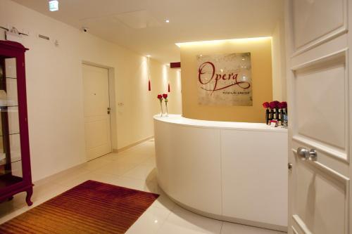 The lobby or reception area at Opera Relais De Charme