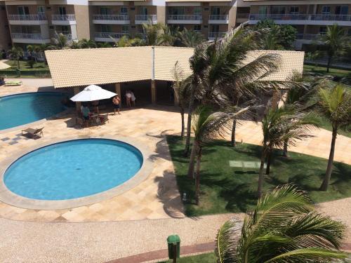 A view of the pool at Ap Paraiso das Dunas - Pé na areia or nearby