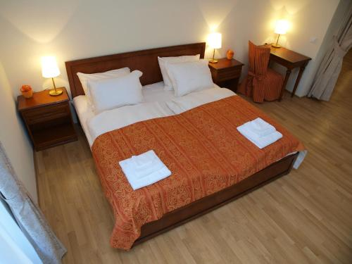 A bed or beds in a room at City Apartment