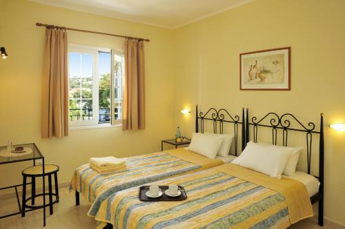 A bed or beds in a room at Balaris Apartments