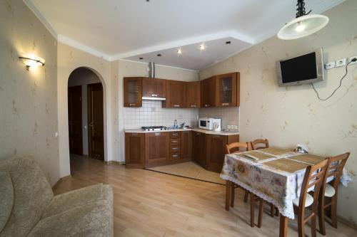Кухня или мини-кухня в Апартаменты Амулет