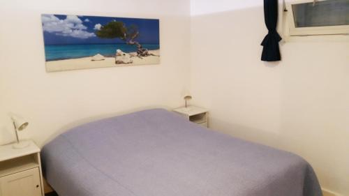 Een bed of bedden in een kamer bij Appartement in Zandvoort