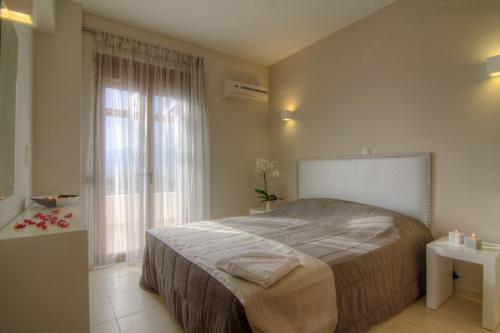Ένα ή περισσότερα κρεβάτια σε δωμάτιο στο Gasparakis Bungalows & Villas
