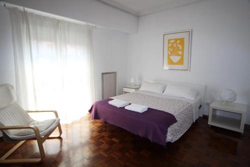 A bed or beds in a room at Apartamentos CalleCultura