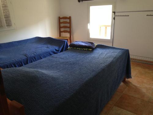 A bed or beds in a room at Maison Les Pieds dans l eau