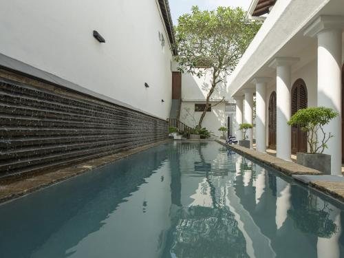 The swimming pool at or near Ambassador's House - an elite haven