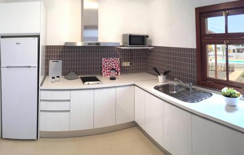 A kitchen or kitchenette at Casa Nimbara