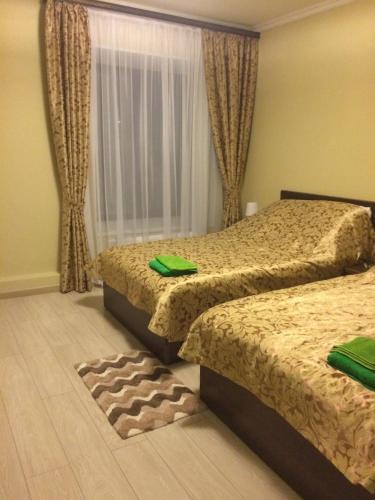 Letto o letti in una camera di Hotel Nadezhda