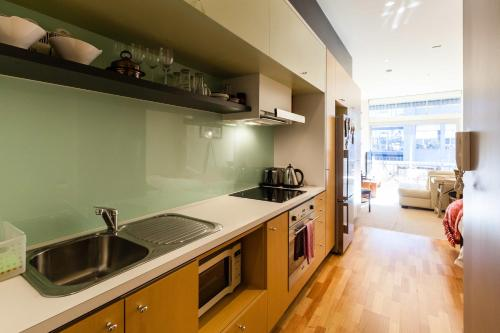 A kitchen or kitchenette at Tennyson - Beyond a Room Private Apartments