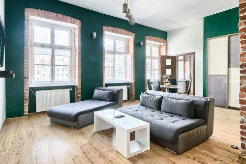 A seating area at Urban Apartments