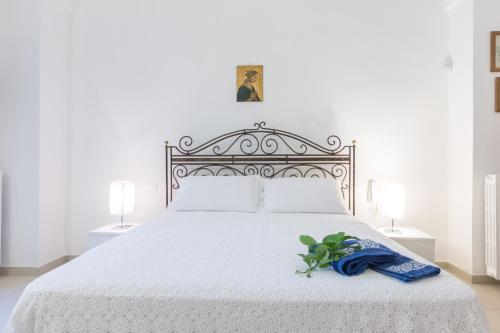 A bed or beds in a room at Il Melograno