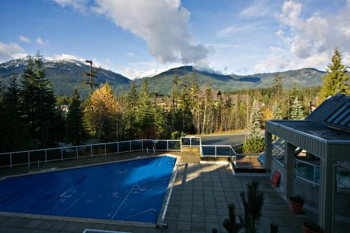 The swimming pool at or near Wildwood Lodge by Westwind Properties