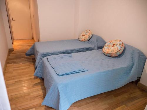 A bed or beds in a room at Mendoza 5056