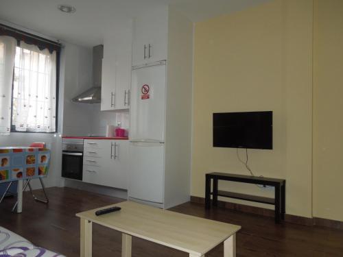 A television and/or entertainment center at Apartamento Cuatro Torres