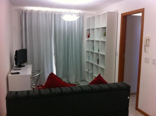 Ruang duduk di Flat Ed Praia Dourada
