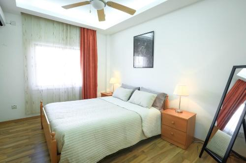 A bed or beds in a room at Achillion Apartments