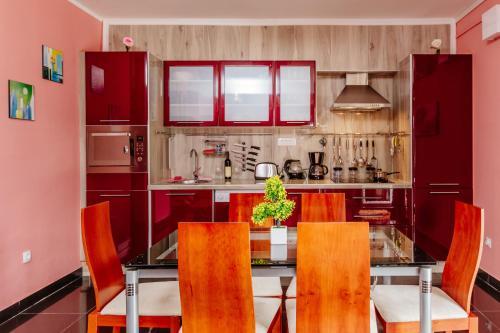 A kitchen or kitchenette at Bigova Sea Views Apartments
