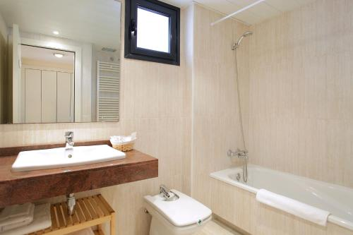 A bathroom at Apartment Olympic Village