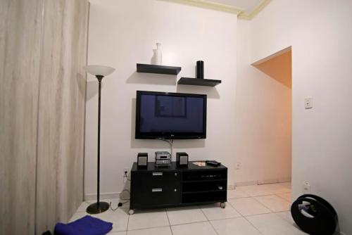 En tv och/eller ett underhållningssystem på Copa´s Apartment