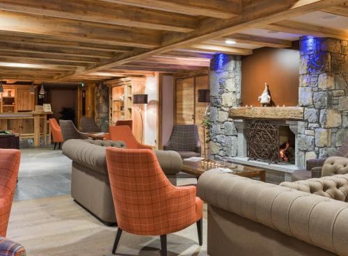 The lounge or bar area at CGH Résidences & Spas Les Chalets De Laÿssia