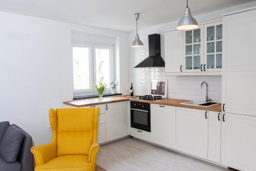 A kitchen or kitchenette at Life Inn Apartment
