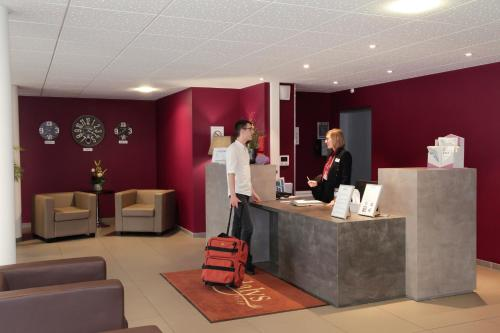 The lobby or reception area at Odalys City Rennes Lorgeril