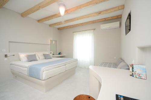 A bed or beds in a room at Antony Suites (Adults Only)