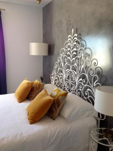 A bed or beds in a room at Vivenda Brito
