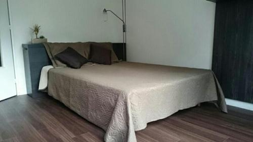 A bed or beds in a room at Appartement Les Tilleuls