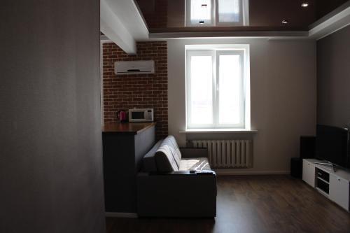Гостиная зона в Apartment Tsentr Mir