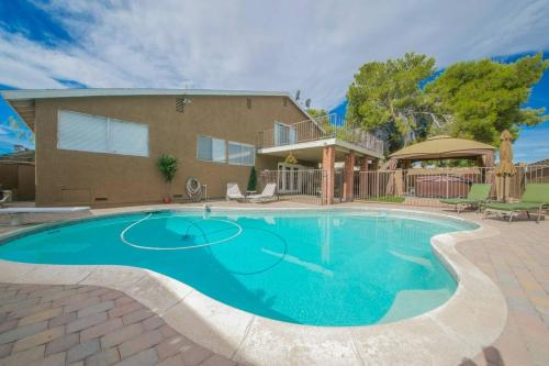 The swimming pool at or near 4 Bedroom House in Groveview Lane, Las Vegas