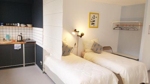 Ein Bett oder Betten in einem Zimmer der Unterkunft Minitel