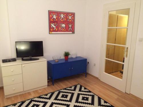 Coin salon dans l'établissement Studio Apartment Nala