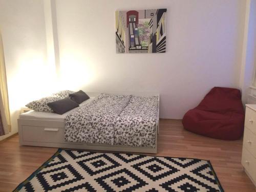 Un ou plusieurs lits dans un hébergement de l'établissement Studio Apartment Nala