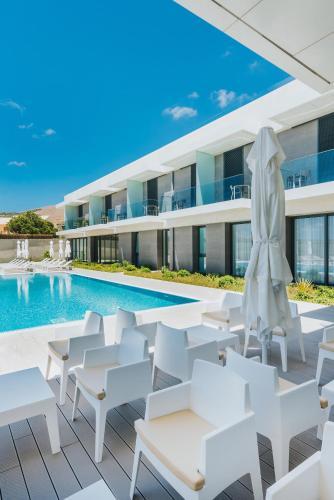 The swimming pool at or close to Pestana Ilha Dourada Hotel & Villas