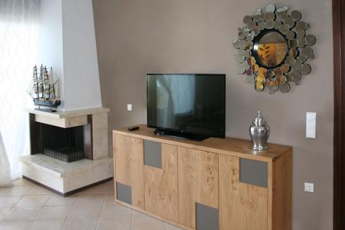 A television and/or entertainment center at Paressa Villas