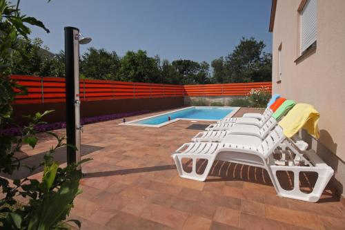 The swimming pool at or near Holiday Home Leni