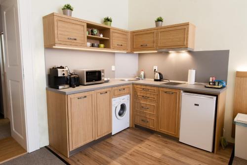 A kitchen or kitchenette at Karlova 25 Apartments