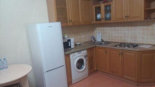 A kitchen or kitchenette at Apartment On Navoi 208