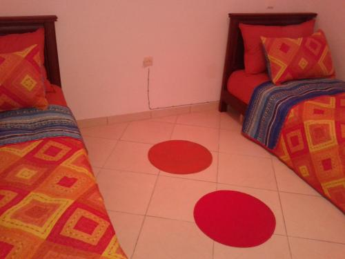 A bed or beds in a room at Appartement Résidence Al Gharsa