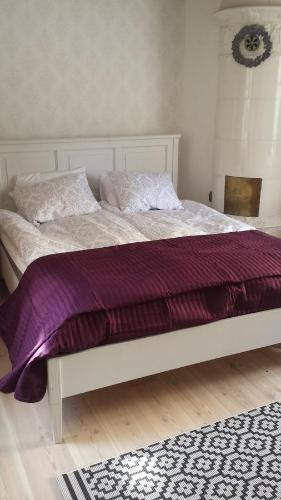 Säng eller sängar i ett rum på Lilla Munkhagen