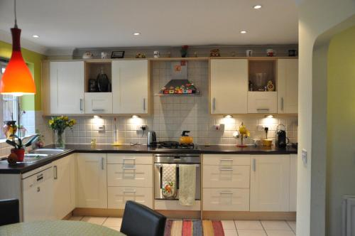 A kitchen or kitchenette at Chancellor Park Holiday Let