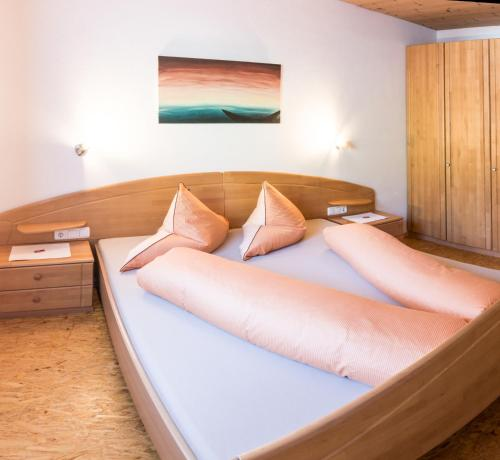 A bed or beds in a room at Haus Binder