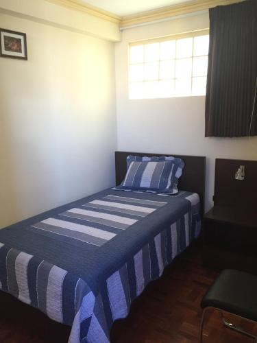 A bed or beds in a room at Residencial Alta Vista
