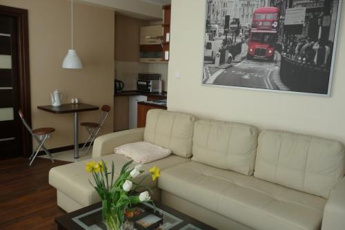 A seating area at Apartament Bella Nova Centrum