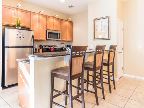 A cozinha ou kitchenette de Coco Palm Townhome 8964
